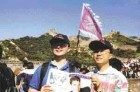 Dr. David Choy and Dr. Peter Choy take a moment to read Oral Health while walking on the Great Wall, China.