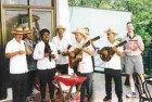 A local band playing near Havana, Cuba, momentarily distracts Dr. Michael Pollak from his November '99 Oral Health.