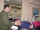 FIGURE 3--Cranial sacral therapy -- craniosacral therapy can easily be done in the dental setting at the end of a long appointment to help relax fatigued muscles.