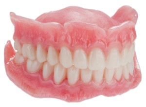 FIGURE 17. Initial insertion of maxillary and mandibular complete dentures by third appointment.