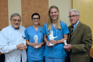 AO faculty co-advisor Lawrence Gettleman, D.M.D., M.S.D., professor of prosthodontics and biomaterials, Sara Nelson, AO member and third year dental student, Holly Bradford, AO president and third year dental student, and AO faculty co-advisor Lee Mayer, M.S., D.M.D., F.A.C.D., associate professor and director of Community Dental Health.