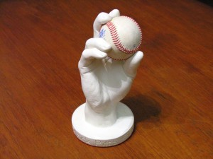 Custom-made 3D plaster cast of hand holding a baseball.