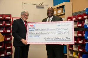 Stanley M. Bergman, Chairman of the Board and Chief Executive Officer of Henry Schein, presents Charles Redding, Chief Executive Officer and President of MedShare, with a $25,000 donation to become the first corporate sponsor of MedShare's newly created Disaster Relief Fund. (PRNewsFoto/Henry Schein, Inc.)