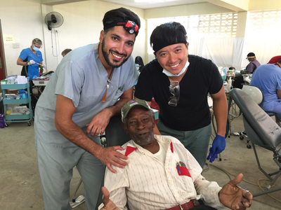 Dr. Arsalan Poorsina (multiple practice, Ontario) and Ron Fung (private equity investor) pose with Whitehouse clinic's favourite patient: 84-year-old Cephas A. Clarke. The volunteers at Whitehouse clinic raised money to get Mr. Clarke dentures. He thanked us (including literally singing our praises) for coming down and helping his people.
