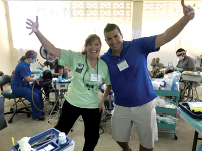 Dental Hygiene Instructor Sharon Crawford (left) with Michael Carabash posing at Whitehouse clinic.
