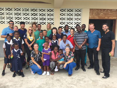 Team Whitehouse outside their clinic in Jamaica.