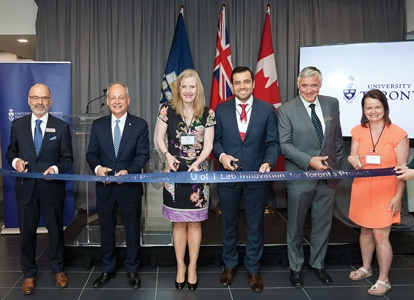 Ribbon-Cutting: (L to R) Daniel Haas, Professor and Dean, Faculty of Dentistry; U of T President Meric Gertler; Chair of U of T's Governing Council Claire Kennedy; Dentistry Master's graduate Terry Stavroullakis; Dentistry's Vice Dean of Research, Professor Bernhard Ganss; and Marianne Bruin, Senior Communications Advisor from Innovation, Science and Economic Development Canada.