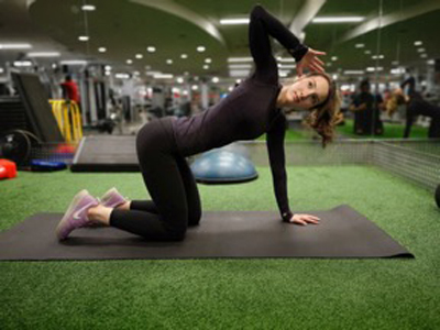 A demonstration of the full extension position of a thoracic extension.