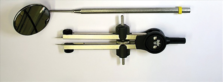 """Instruments used for diagnostic preview/mock-up – 1½"""" Indianhead mirror (front face) [Miltex – York, PA] – Caliper/orthodontic divider."""