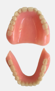 Photograph of existing full upper and lower dentures.