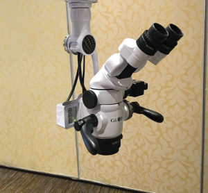 Dental operating microscopes (left: Carl Zeiss, Toronto, ON and right: Global Surgical, St. Louis, MO) providing enhanced visualization during root canal treatment.