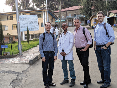 (left to right) Dr. Karl Cuddy (U of T OMFS Faculty), Dr. Demerew Dejene, Dr. Marco Caminiti, Dr. Michael Laschuk in front of St. Peter Specialized Hospital main entrance.