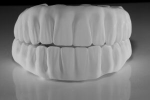 After any changes the solid zirconia is milled followed by manual shaping and texturizing in a green stage