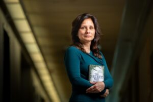 """University at Buffalo professor Mary Bush's new novel, """"The Secrets We Bury,"""" the sequel to her acclaimed first book, follows dentist-turned-death-scene-investigator Valentina Knight. Photographer: Meredith Forrest Kulwicki"""