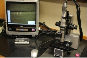 Measurement of the thickness of floss using 100x magnification in a digital light microscope.